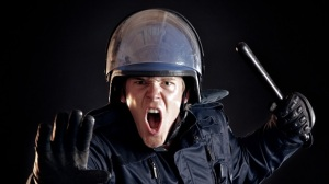 Angry-police-officer-with-nightstick-via-Shutterstock